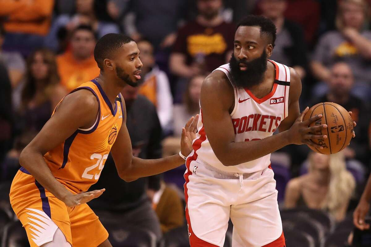 PHOENIX, ARIZONA - FEBRUARY 07: James Harden #13 of the Houston Rockets handles the ball against Mikal Bridges #25 of the Phoenix Suns during the second half of the NBA game at Talking Stick Resort Arena on February 07, 2020 in Phoenix, Arizona. NOTE TO USER: User expressly acknowledges and agrees that, by downloading and or using this photograph, user is consenting to the terms and conditions of the Getty Images License Agreement. Mandatory Copyright Notice: Copyright 2020 NBAE. (Photo by Christian Petersen/Getty Images)
