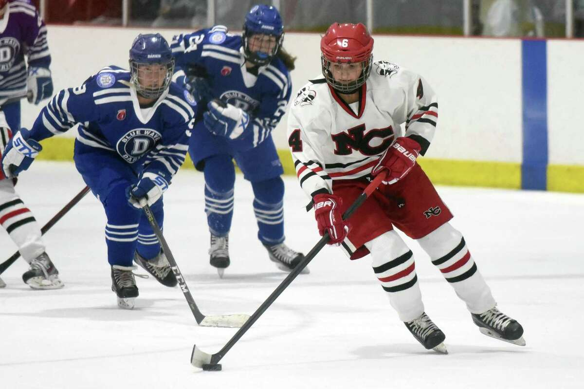 New Canaan's Kaleigh Harden (4) skates with the puck during a girls ice hockey game against Darien at the Darien Ice House on Saturday, Jan. 4, 2020.