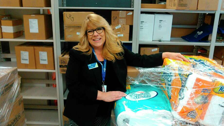 A Credit Union employee collects donated items. (Provided photo)