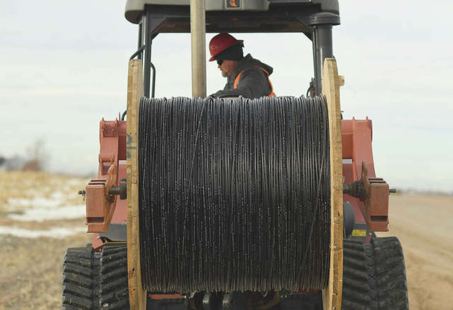 Dana Sharp runs a Ditch Witch, digging a line to lay fiber optic cable for high-speed internet. Photo: R.J. Sangosti | MediaNews Group (Getty Images)