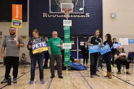 DES MOINES, IOWA - FEBRUARY 03:  Supporters of Democratic presidential candidates former South Bend, Indiana Mayor Pete Buttigieg and Sen. Amy Klobuchar (D-MN) prepare to caucus for them in the gymnasium at Roosevelt High School February 03, 2020 in Des Moines, Iowa. Iowa is the first contest in the 2020 presidential nominating process with the candidates then moving on to New Hampshire. (Photo by Chip Somodevilla/Getty Images)