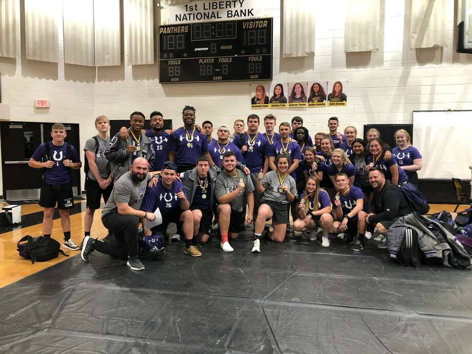 Coach B. J. Whitehead, Coach Bobby Little, along with the Boys and Girls Powerlifting Teams show off the hardware they collected at the Liberty Powerlifting Invitational last week. Photo: Submitted
