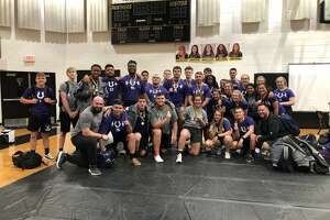 Coach B. J. Whitehead, Coach Bobby Little, along with the Boys and Girls Powerlifting Teams show off the hardware they collected at the Liberty Powerlifting Invitational last week.