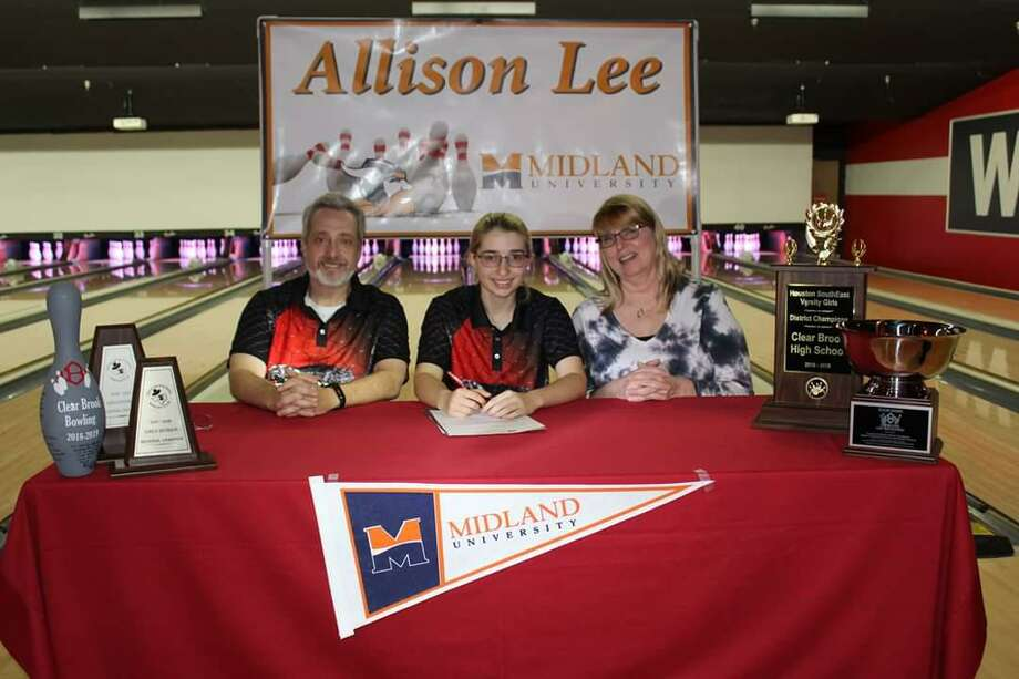 Clear Brook bowler Allison Lee has signed a national letter of intent with Midland University. Lee, a fourth-year varsity member, is shown with her parents Jason and Nanette. Photo: Submitted Photo
