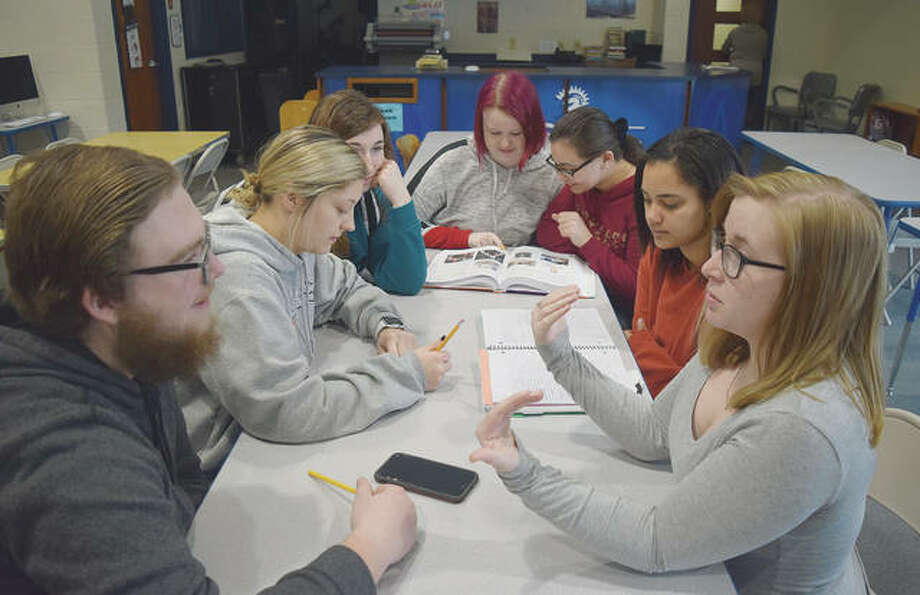 North Greene High School seniors, from left, Samuel Newingham, Lana Schutz, Shelbey Ford, Leah Sherwin, Cecilia Nassar, Dajha Fane and Abigail Palmer hit the books as part of the first year of the school's certified nursing assistant program. Photo: Marco Cartolano | Journal-Courier