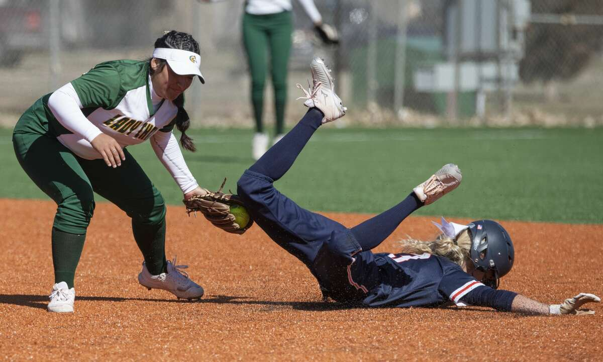 Midland College's Crystal Soliz makes the tag for an out 02/08/2020 as Snow College's Marae Condie tries to steal second in the first game of a double header against at MUGS field. Tim Fischer/Reporter-Telegram
