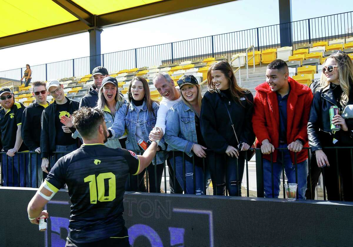 Houston SaberCats outside half Sam Windsor is greeted by fans after a game against the Colorado Raptors on Saturday, Feb. 8, 2020, at Aveva Stadium in Houston.