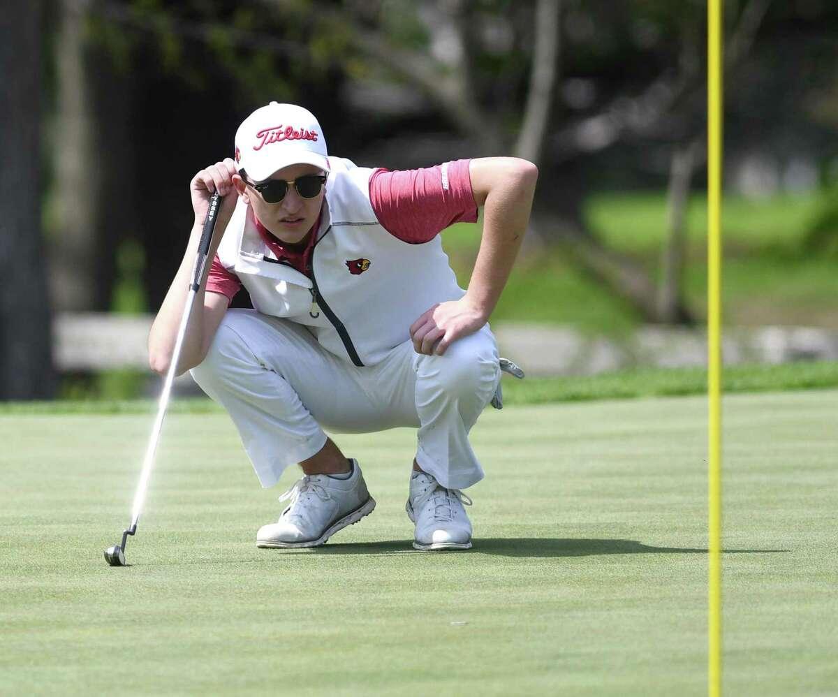 Greenwich's Ben Ropiak lines up a putt during a tournament last season.