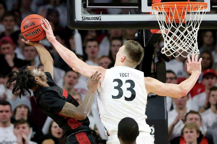 Center Chris Vogt (33) and the Cincinnati men's basketball team take on UConn on Sunday in Storrs. Photo: Kareem Elgazzar / Associated Press / Kareem Elgazzar, The Cincinnati Enquirer
