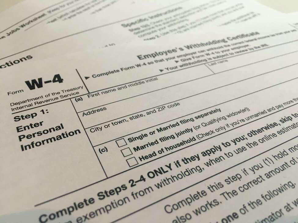 This Wednesday, Feb. 5, 2020 photo shows the W-4 form in New York. The IRS has introduced a new Form W-4 that must be used by all employers in 2020 to better accommodate recent changes to the tax law. A It's the biggest overhaul of the form in decades. It can require a bit more legwork but in return, the IRS says it will yield more accurate results. (AP Photo/Patrick Sison)