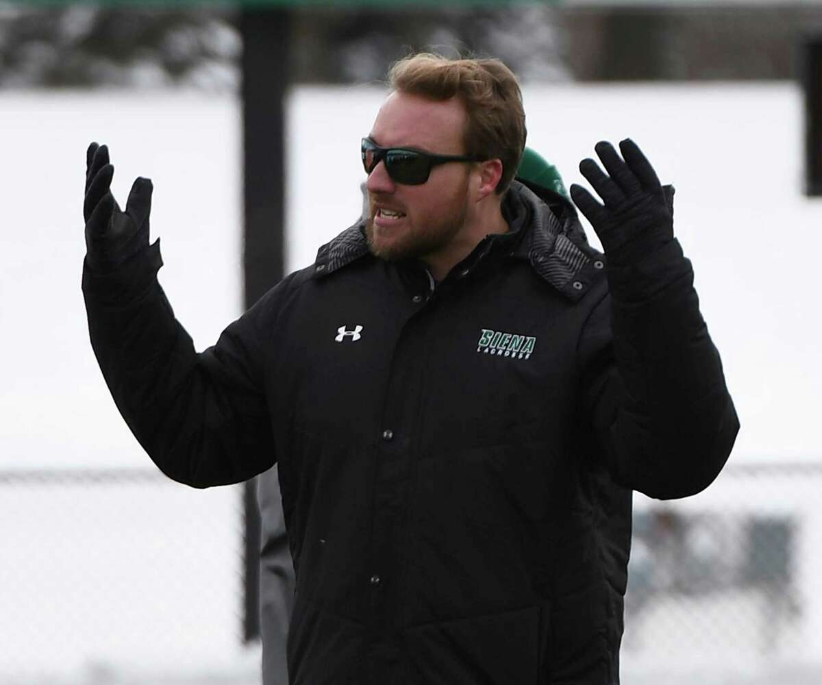Siena men's lacrosse head coach Liam Gleason gestures to players on the sidelines during Siena's season opener against Long Island University at the college's Hickey Field on Saturday, Feb. 8, 2020 in Latham, N.Y. (Jenn March, Special to the Times Union )