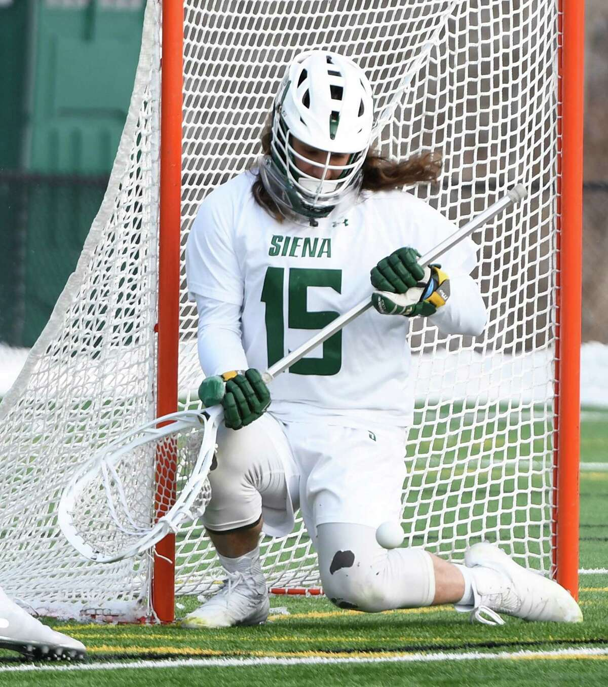 Siena goaltender Anthony Tebbano saves a shot during Siena's season opener against Long Island University at the college's Hickey Field on Saturday, Feb. 8, 2020 in Latham, N.Y. (Jenn March, Special to the Times Union )