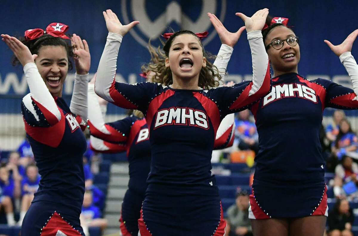 The Brien McMahon High School cheerleading squad competes during the FCIAC cheerleading championships at Wilton High School in Wilton, Conn.