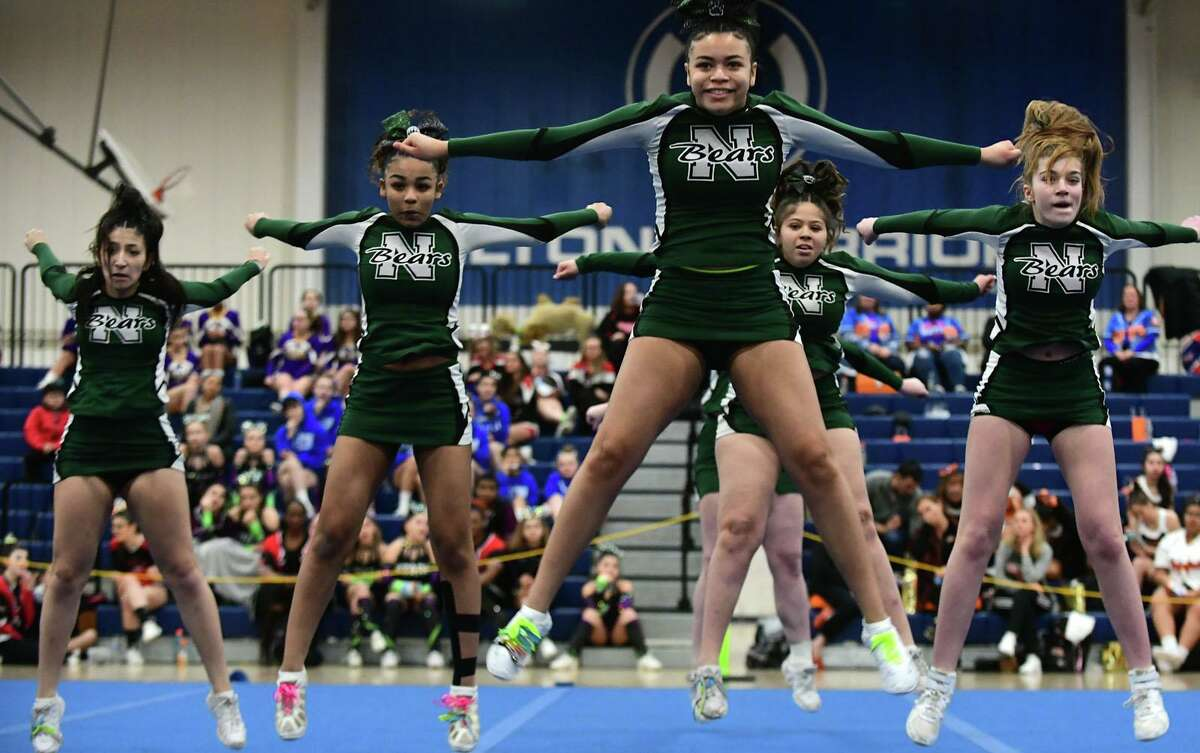 The Norwalk High School cheerleading squad competes during the FCIAC cheerleading championships at Wilton High School in Wilton, Conn.