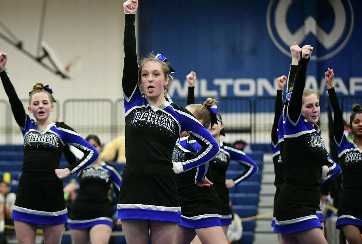 The Darien High School cheerleading squad competes during the FCIAC cheerleading championships at Wilton High School in Wilton, Conn.