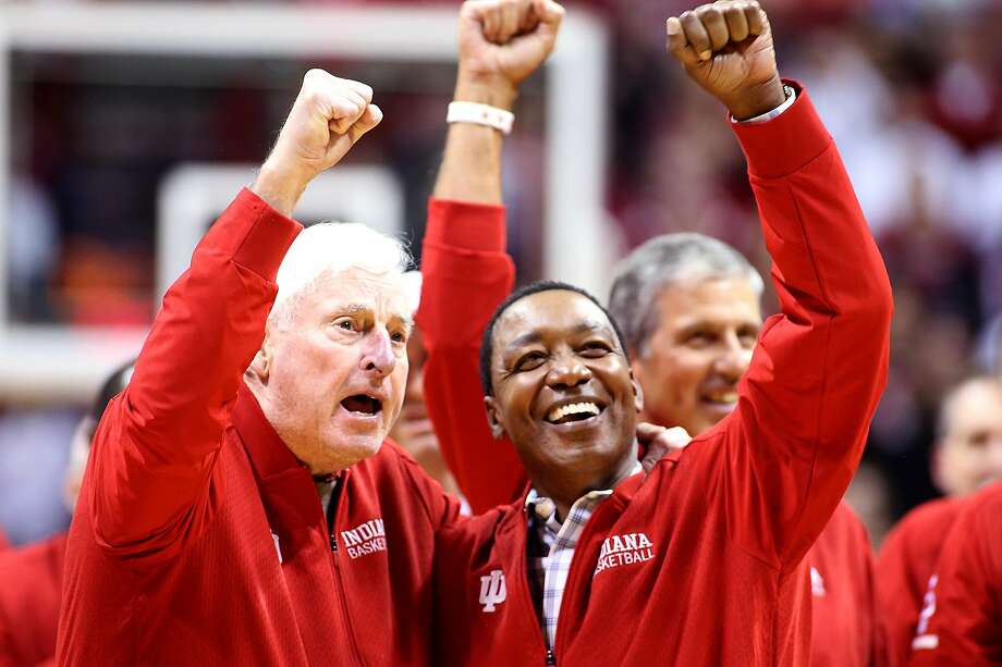 Former Indiana head coach Bob Knight and former Hoosiers player Isiah Thomas lead the crowd in cheers during a halftime ceremony. Knight was fired by Indiana in 2000. Photo: Justin Casterline / Getty Images