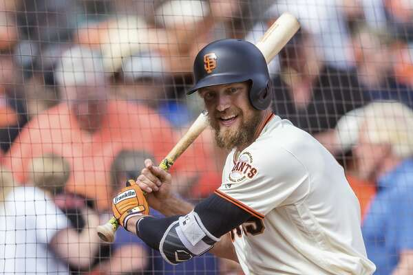 FILE - In this Sept. 30, 2018, file photo, San Francisco Giants Hunter Pence waits on deck club before batting against the Los Angeles Dodgers in the ninth inning of a baseball game in San Francisco. Pence is returning to the Giants, agreeing to a contract that will give the young club a veteran presence in both the outfield and clubhouse in a season of big change ahead. A person with direct knowledge of the deal said Friday, Feb. 7, 2020, that Pence had reached agreement pending a physical. The person spoke to The Associated Press on condition of anonymity because no announcement had been made. (AP Photo/John Hefti)