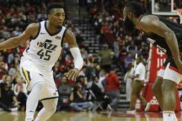 HOUSTON, TX - OCTOBER 24: Donovan Mitchell #45 of the Utah Jazz dribbles the ball defended by James Harden #13 of the Houston Rockets in the first half at Toyota Center on October 24, 2018 in Houston, Texas. NOTE TO USER: User expressly acknowledges and agrees that, by downloading and or using this Photograph, user is consenting to the terms and conditions of the Getty Images License Agreement. (Photo by Tim Warner/Getty Images)