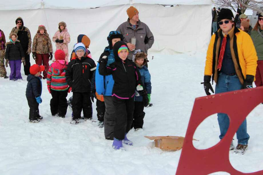 """A young competitor takes aim in the """"snowball"""" throwing contest. (Photo/Colin Merry)"""