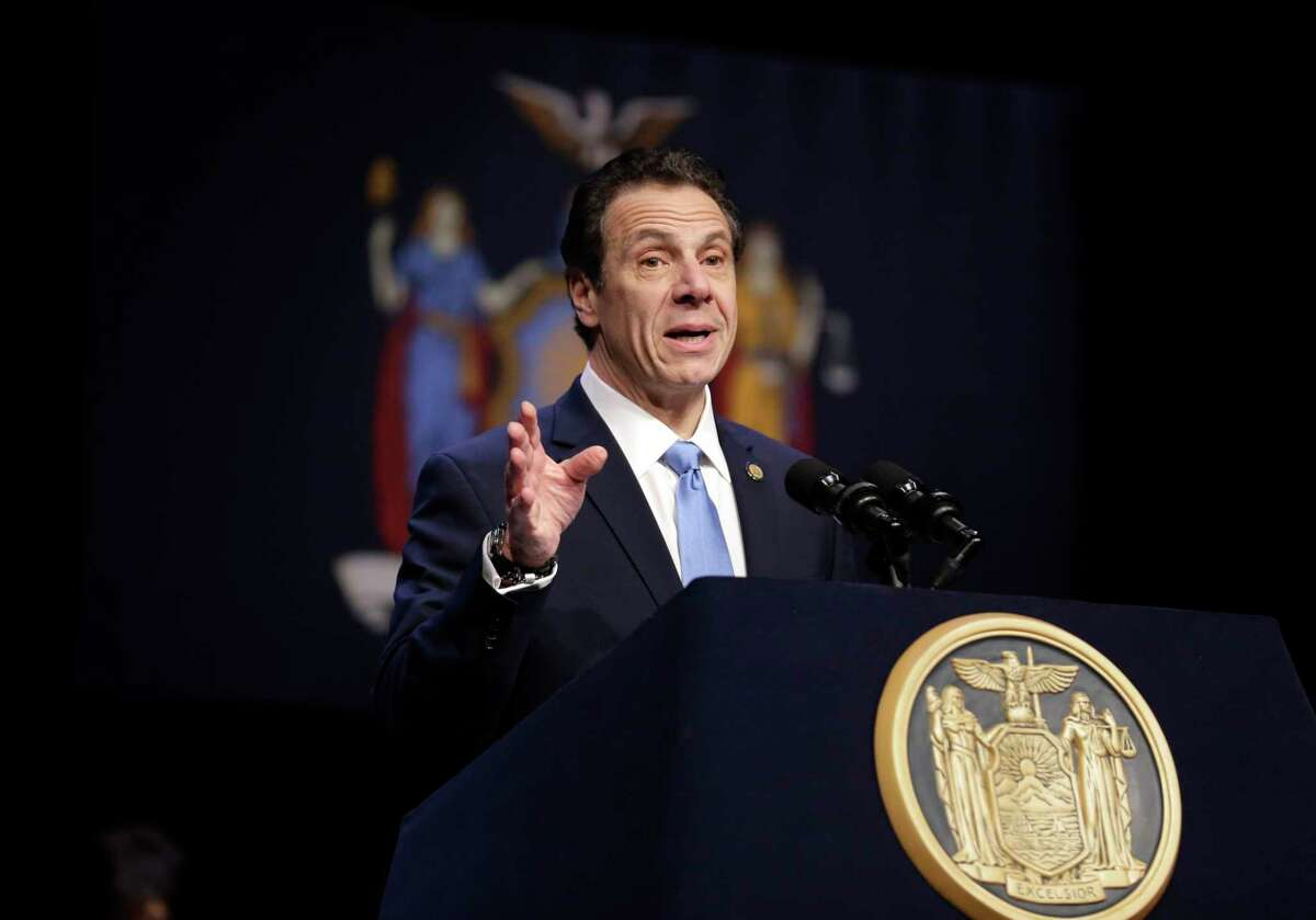FILE - In this Feb. 25, 2019 file photo, New York Gov. Andrew Cuomo speaks during a bill signing ceremony in New York. Cuomo says his state will file a lawsuit challenging the Trump administration's plan to block New Yorkers from enrolling in