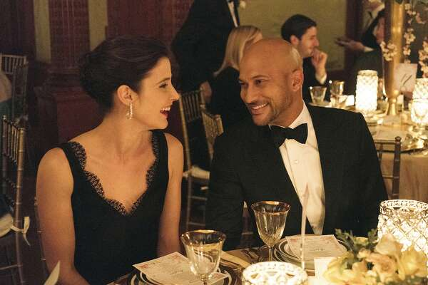 "This image released by Netflix shows Cobie Smulders, left, and Keegan-Michael Key in ""Friends From College."" Key is transitioning out of over-the-top comedies to focus more on dramatic films. (Barbara Nitke/Netflix via AP)"
