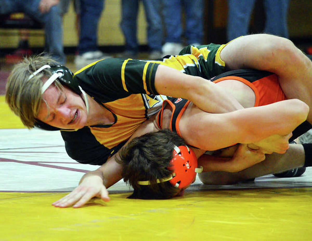 Metro-East Lutheran's Caiden Downs, top, wrestles Matt Page of Hillsboro in a first-round consolation match at 138 pounds.