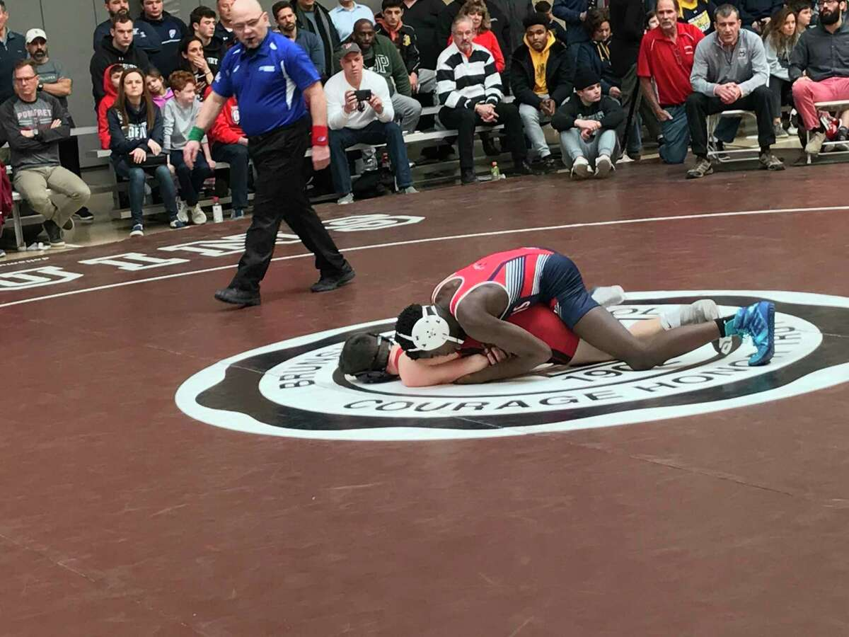 Ronnie Christolin of Greens Farms Academy, on top, wrestles Kellen Horst of Pomfret in the 120-pound title match at the Western New England Independent School Wrestling Association Championships on Saturday, February 8, 2020, at Brunswick School in Greenwich, Connecticut.