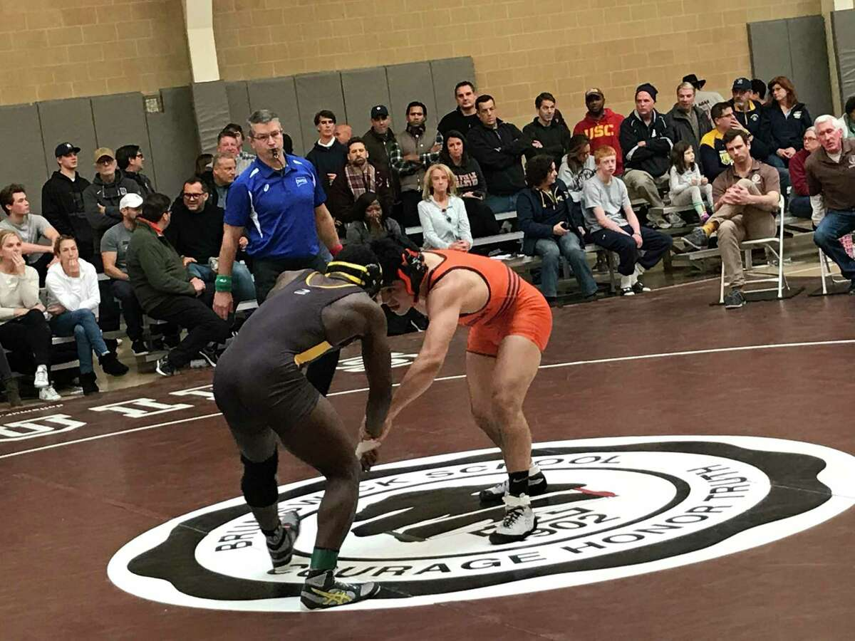 Nadji Ngbokoli of Brunswick, left, won the 170-pound weight class at the Western New England Independent School Wrestling Association Championships on Saturday, February 8, 2020, at Brunswick School in Greenwich, Connecticut.