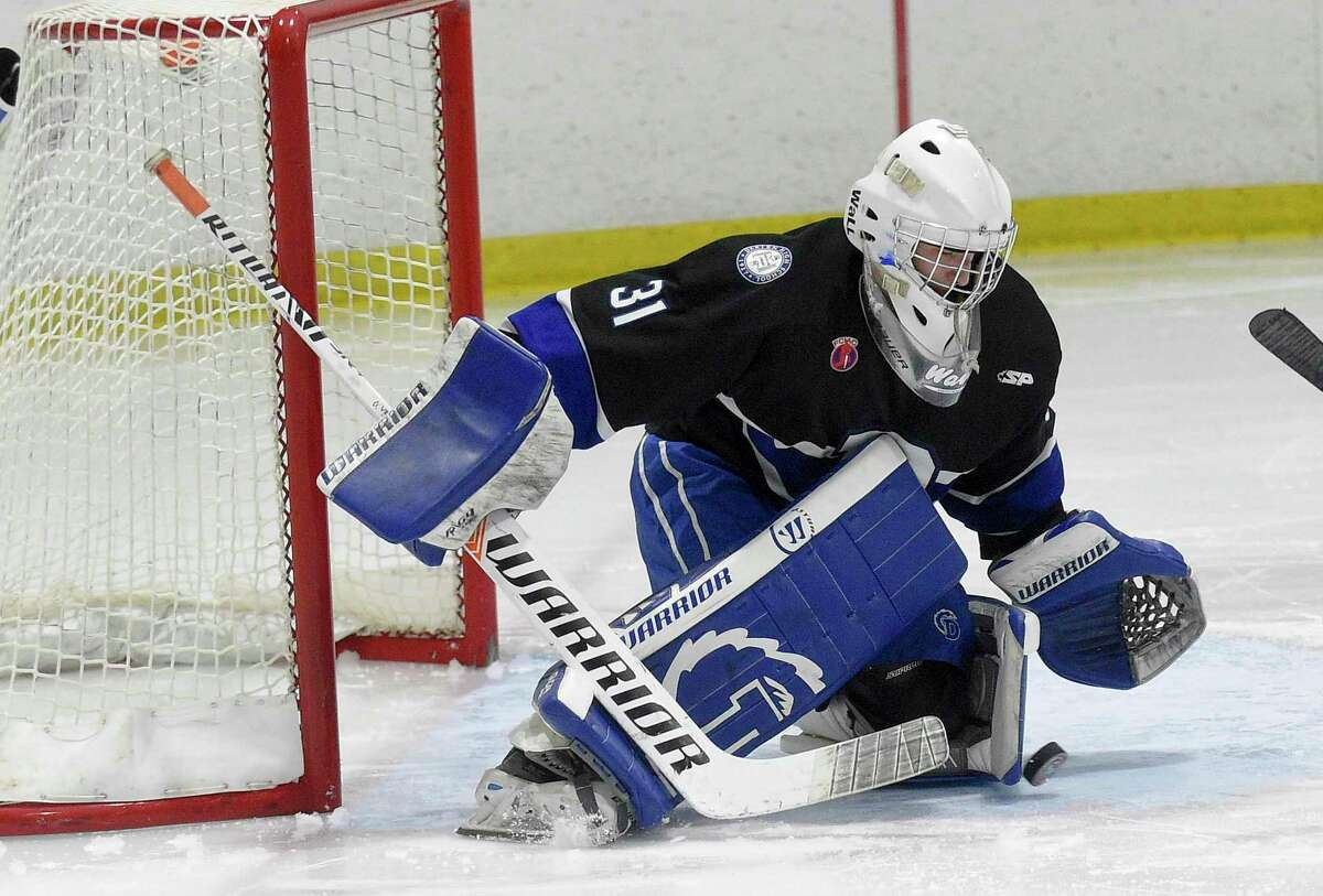 Darien goalie Chris Schofield makes a save in front of his net in the second period of an FCIAC boys hockey game against New Canaan at the Darien Ice House on Feb. 8, 2020 in Darien, Connecticut. Darien won 10-2.