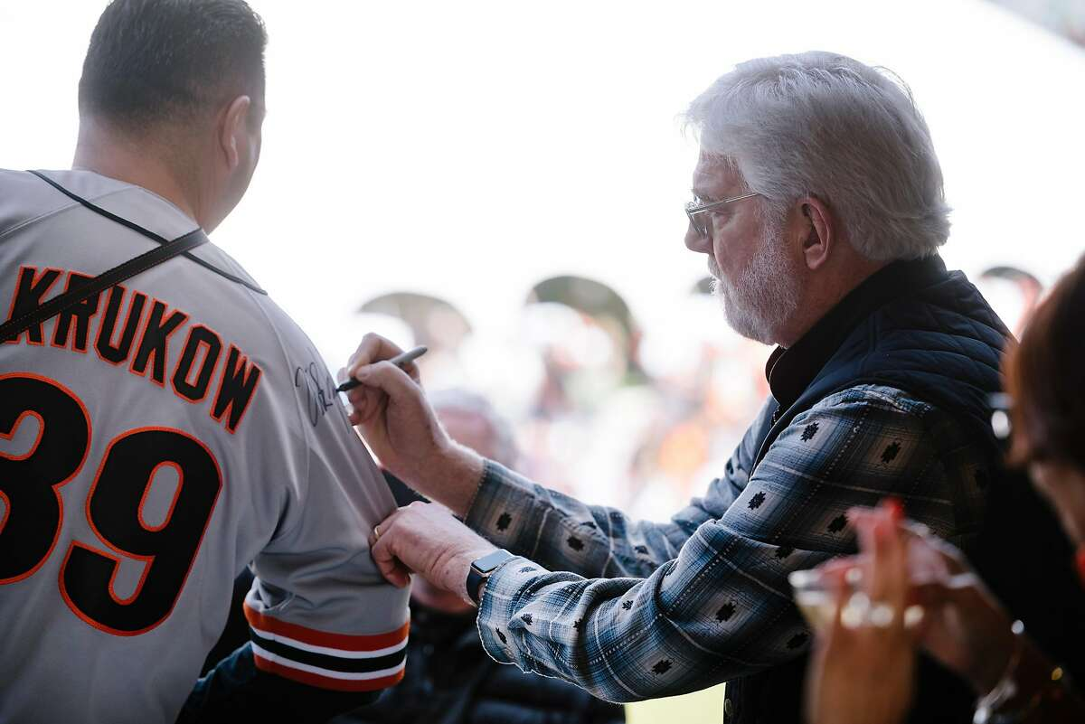 Giants broadcast announcer Mike Krukow signs a fans jersey during the San Francisco Giants Fan Fest event at Oracle Park in San Francisco, California, U.S., on Saturday, Feb. 8, 2020.