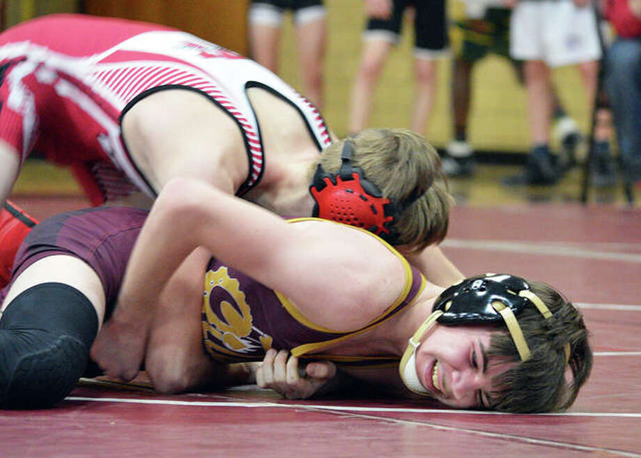 EA-WR's Aaron Niemeyer (bottom) wrestles Vandalia's Jarek Wehrle in a 106-pound semifinal Saturday at the Class 1A regional in Wood River. Niemeyer lost a 3-0 decision, but came back to place third. Wehrle (40-1) went on to win the title. Photo: Scott Marion / Hearst Midwest