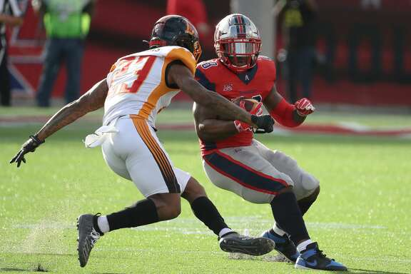 Houston Roughnecks running back James Butler (28) toys to get around LA Wildcats cornerback Mike Stevens (23) during the first quarter of an XFL football game at TDECU Stadium on Saturday, Feb. 8, 2020, in Houston.