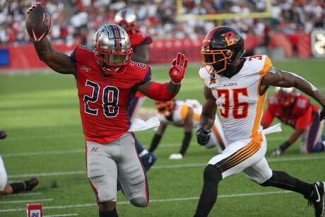 Houston Roughnecks running back James Butler (28) scores a touchdown during the second quarter of an XFL football game at TDECU Stadium on Saturday, Feb. 8, 2020, in Houston.