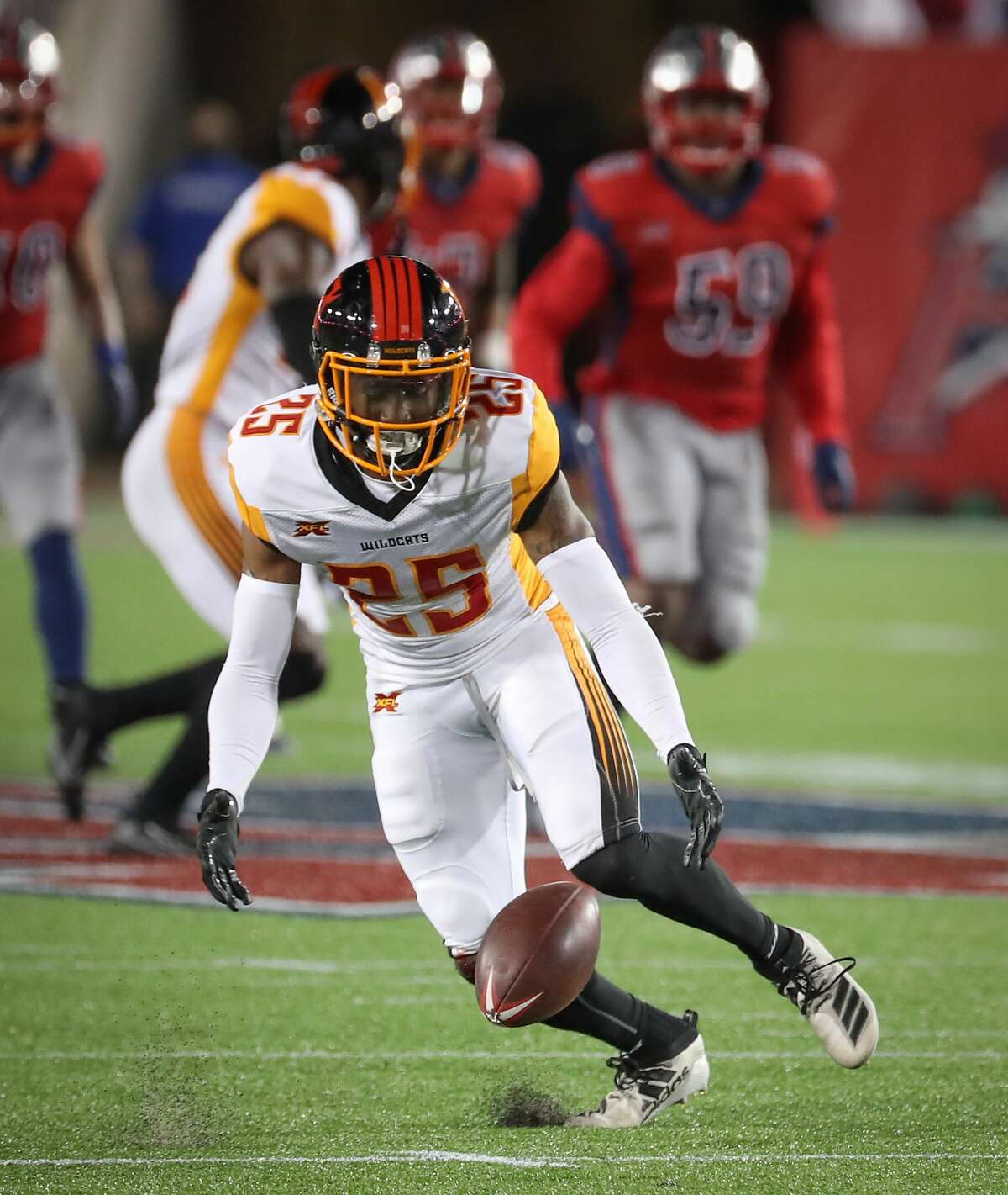 LA Wildcats cornerback Roman Tatum (25) fumbles a kick return during the fourth quarter of an XFL football game at TDECU Stadium on Saturday, Feb. 8, 2020, in Houston.