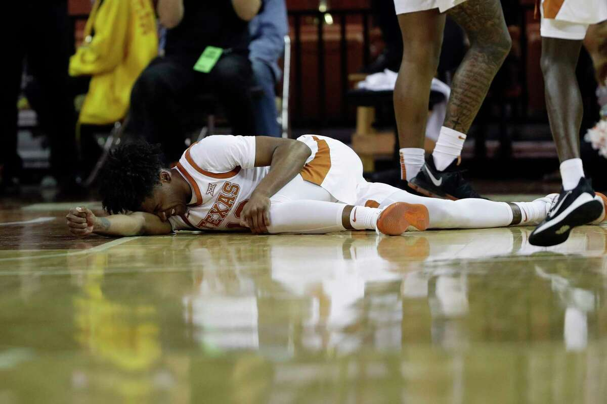 Texas guard Jase Febres (13) lies on the court after an injury during the second half of an NCAA college basketball game against Texas Tech, Saturday, Feb. 8, 2020, in Austin, Texas. Texas Tech won 62-57. (AP Photo/Eric Gay)