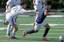Concordia Lutheran's Benjamin Smith, left, tries to sow down Central Catholic's Jose Gallegos during Saturday's TAPPS Division I second-round game. Gallegos, a North Carolina State commit, couldn't be slowed down as he scored two goals.