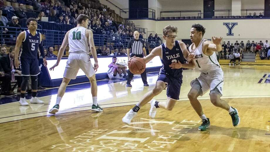 Dartmouth's Taurus Samuels impedes the drive of Yale's Eric Monroe. Photo: Steve Musco / Yale Athletics / © Steve Musco 2019-2020, all rights reserved