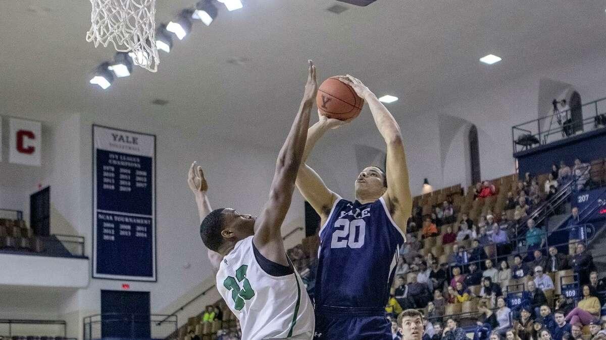 Dartmouth's Chris Knight contesting Yale's Paul Atkinson's short jumper.