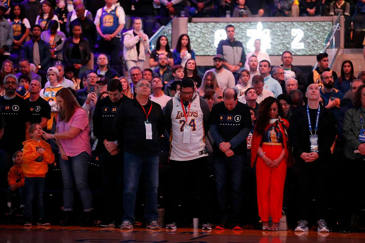 Fans during moment of silence for Kobe Bryant before Golden State Warriors play Los Angeles Lakers during NBA game at Chase Center in San Francisco, Calif., on Saturday, February 8, 2020.