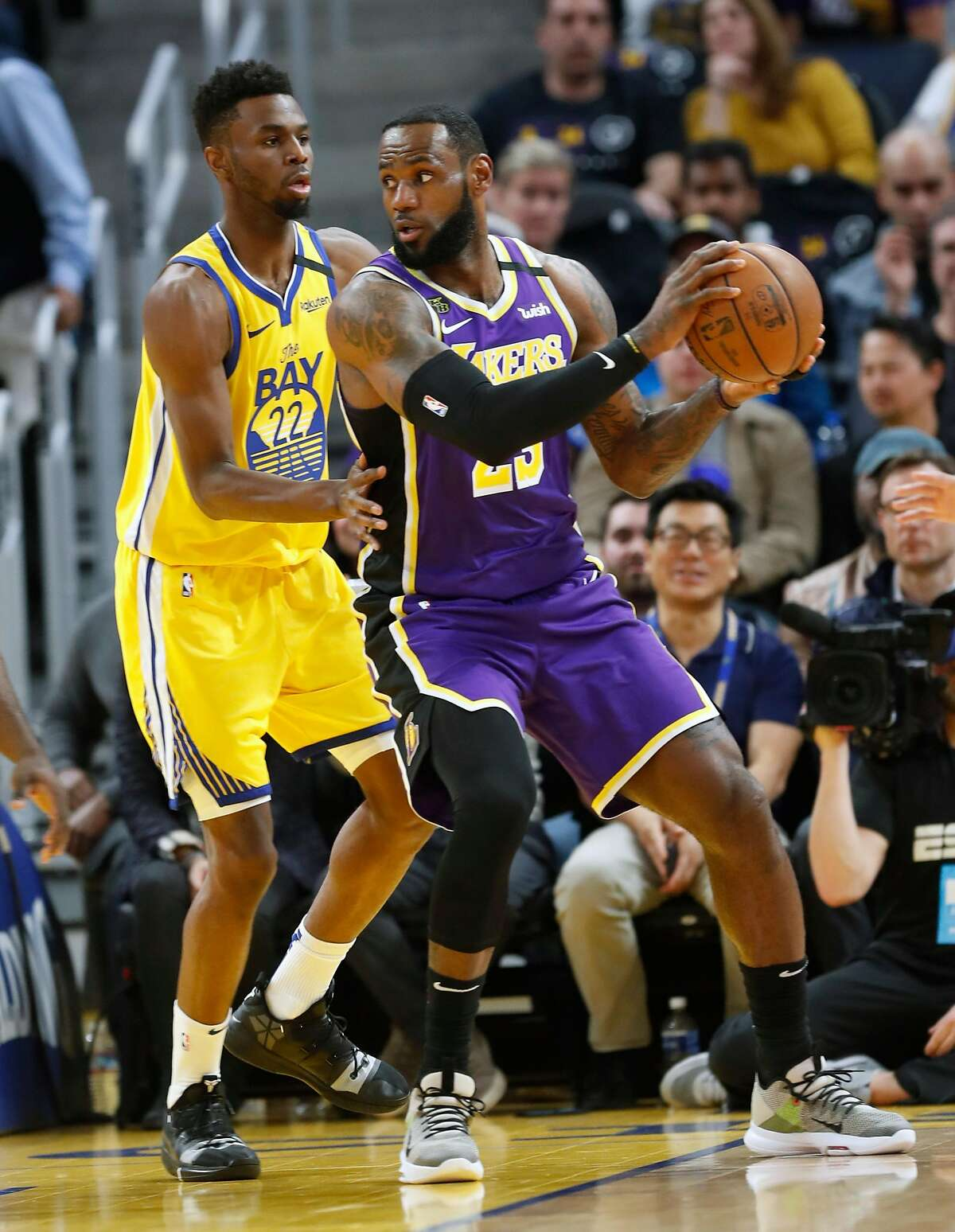 Golden State Warriors' Andrew Wiggins guards Los Angeles Lakers' LeBron James in 1st quarter during NBA game at Chase Center in San Francisco, Calif., on Saturday, February 8, 2020.
