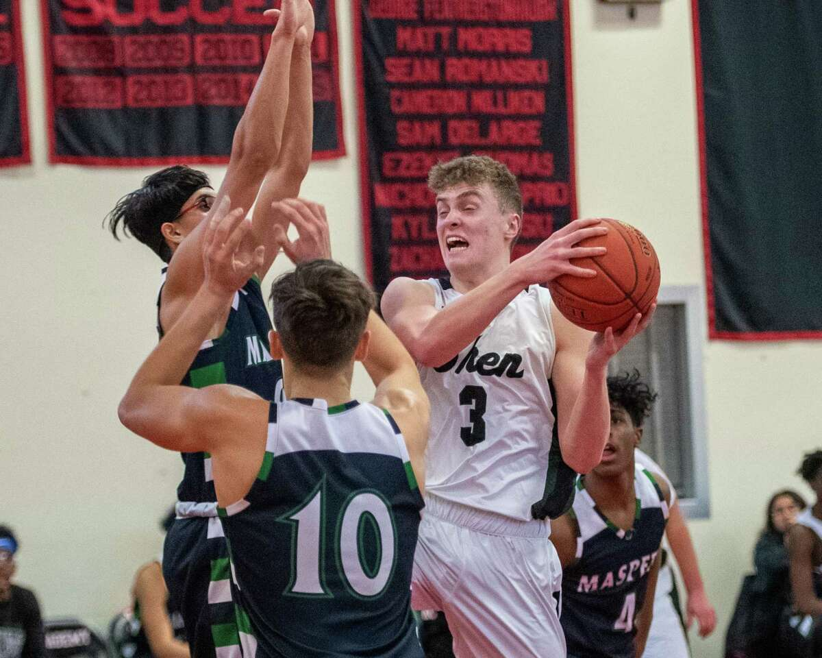 Shenendehowa junior Luke Lavery grabs a rebound in front of Maspeth High School senior Jesse Morales (10) and senior Avner Yashayev during a game at Albany Academy on Saturday, Feb. 8, 2019 (Jim Franco/Special to the Times Union.)