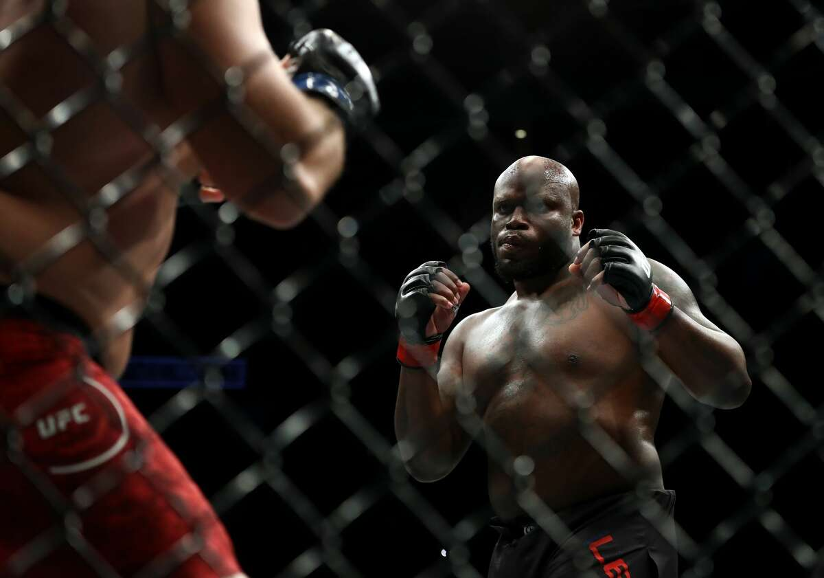 HOUSTON, TEXAS - FEBRUARY 08: (L-R) Ilir Latifi and Derrick Lewis in their Heavyweight bout during UFC 247 at Toyota Center on February 08, 2020 in Houston, Texas. (Photo by Ronald Martinez/Getty Images)
