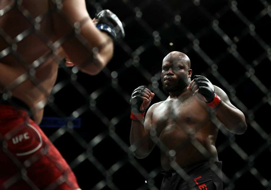 HOUSTON, TEXAS - FEBRUARY 08: (L-R) Ilir Latifi and Derrick Lewis in their Heavyweight bout during UFC 247 at Toyota Center on February 08, 2020 in Houston, Texas. (Photo by Ronald Martinez/Getty Images) Photo: Ronald Martinez/Getty Images