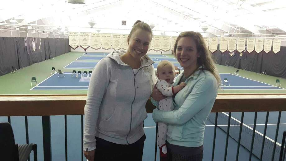 Pictured, from left, are tennispro Valeria Savinykh, seven-month-old Elise Ash, and her mother, Lindsay Ash. Lindsay and her husband, Ryan Ash, of Midland, have welcomed Savinykh into their home during the Dow Tennis Classic the past two years. (Dan Chalk/chalk@mdn.net)