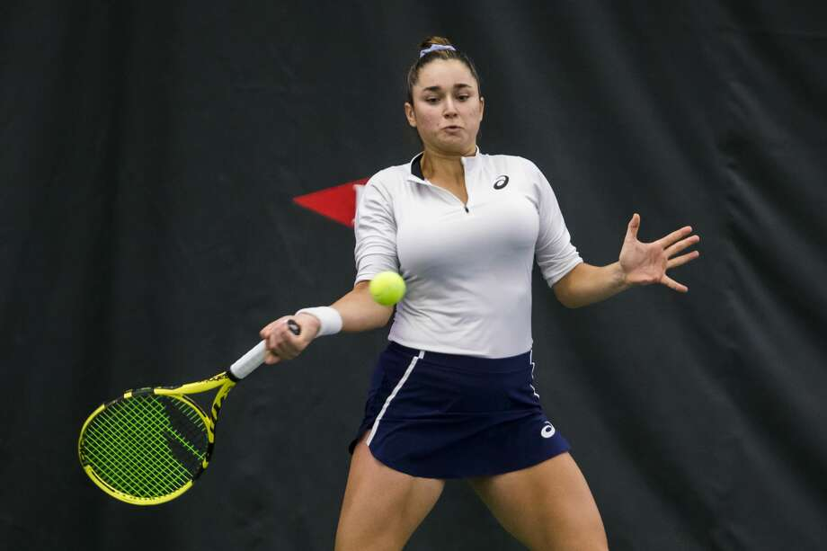 Caroline Dolehide of the USA returns the ball in a doubles match with partner Maria Sanchez of the USA against Yanina Wickmayer of Belgium and Valeria Savinykh of Russia during the Dow Tennis Classic Saturday, Feb. 8, 2020 at the Greater Midland Tennis Center in Midland. (Katy Kildee/kkildee@mdn.net) Photo: (Katy Kildee/kkildee@mdn.net)