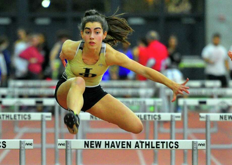 Joel Barlow's Mariella Schweitzer competes in the hurdles during the SWC indoor track championship earlier this month. Photo: Christian Abraham / Hearst Connecticut Media / Connecticut Post
