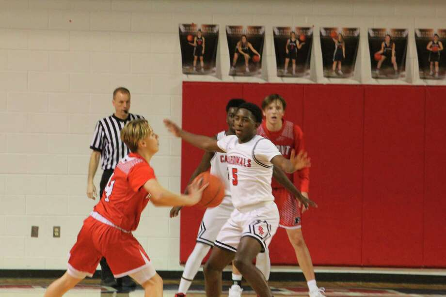 Big Rapids' Dermarcus Lee (5) focuses on defense against Fremont on Friday. (Pioneer photo/John Raffel)
