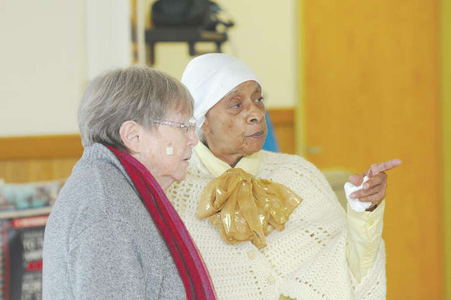 Liliana Costa (left) stands with Ruth Linear, both Jacksonville residents, during the NAACP 2020 Black History Celebration on Saturday. Linear's outfit was a representation of famed abolitionist Harriet Tubman. Photo: Darren Iozia | Journal-Courier