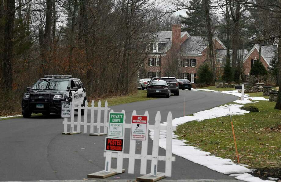 Police vehicles are gathered outside the home of Fotus Dulos, Tuesday, Jan. 28, 2020, in Farmington, Conn. Photo: Jessica Hill / Associated Press / Copyright 2020 The Associated Press. All rights reserved.