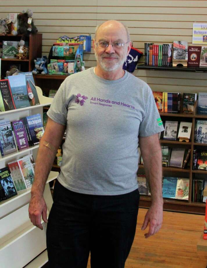 Dan Bailey, who owns the Happy Owl Book Store in Manistee, is looking for public support to help with some All Hands and Hearts projects he will be working on in the Bahamas and Peru in the upcoming months. People can find out more details at give.allhandsandhearts.org/danbbahamasandperu. (Ken Grabowski/News Advocate)